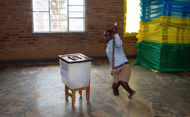 A disabled man prepares to cast his vote at a polling station in Kigali