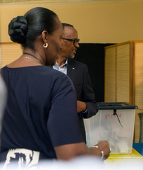Rwandan President Paul Kagame and his wife Jeannette are seen inside a polling centre after casting a vote in Kigali