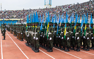 Rwandan army parades before the swearing-in of President-elect Paul Kagame at Amahoro stadium in Kigali