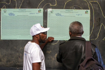 Polling staff are seen at a polling centre in Kigali