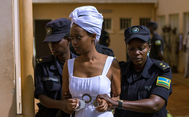 Rwigara, prominent critic of Kagame, is escorted by police in Kigali