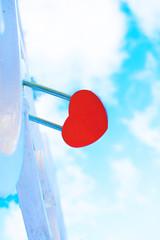 padlock red heart against the sky