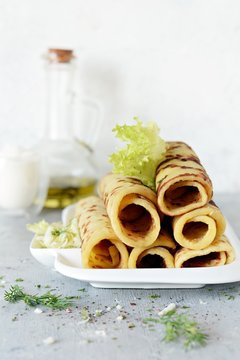 Norwegian potato pancakes Lefse on a light background with cheese and greens. Traditional Scandinavian cuisine.