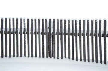 wooden old gray fence in the snow