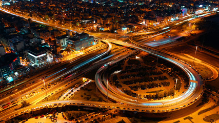 Aerial drone night shot of multilevel junction highway with moderate traffic