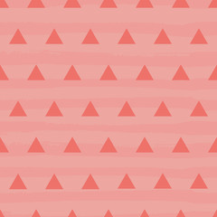 Vibrant coral and pink textured triangle design on a textured stripy grunge background. Seamless vector pattern in relaxed modern style. Perfect for stationery, textiles, home decor, giftwrapping.