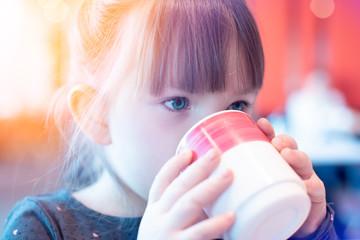 Little girl holding a mug