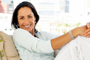 Woman relaxing at home - beautiful middle aged brunette - portrait