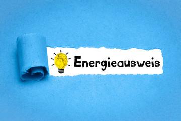 Energieausweis / blaues Papier mit Glühbirne