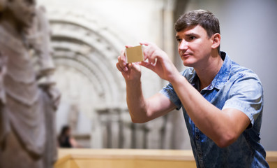 Man taking pictures in historical museum
