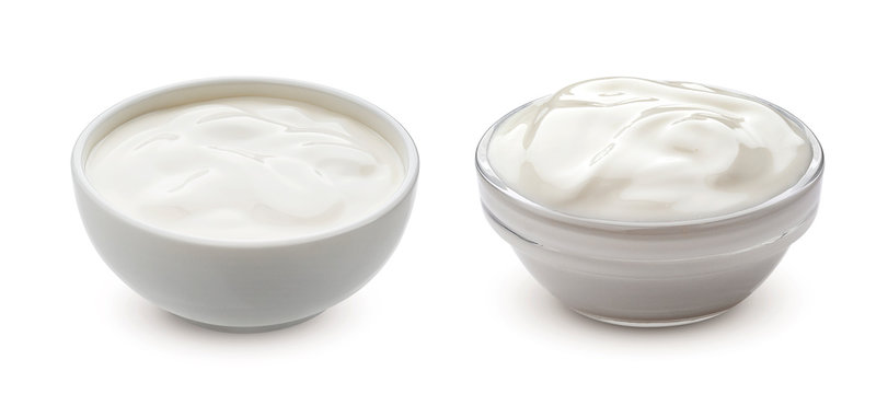 Greek yogurt in bowl isolated on white background