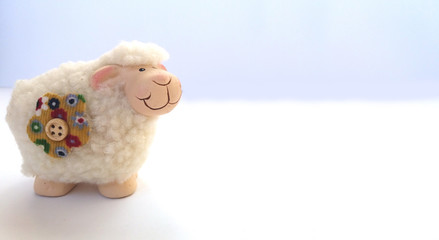 Lamb statuette on white background.