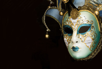 Carnival venetian mask on black background