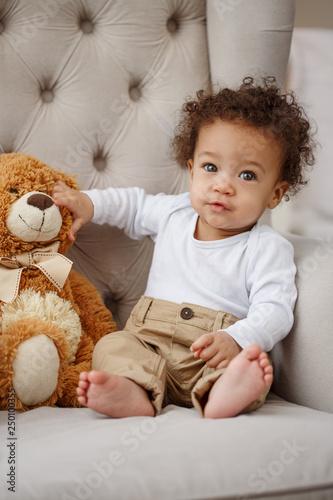 Pretty boy with toy