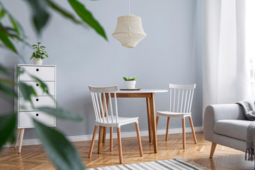 Modern scandinavian decor of living room with design furniture, family table, sofa and plants Brown wooden parquet and stylish carpet.  Nice and minimalistic apartment.  Fototapete
