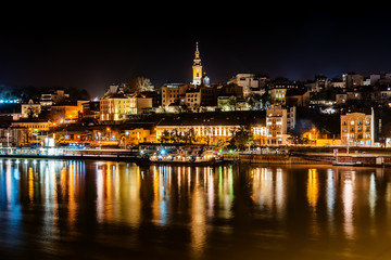 Belgrade, Serbia - February 10, 2019: Panorama of Belgrade with a view from Branko bridge at night with a reflection. View of Cathedral Church of St. Michael the Archangel (serbian: Saborna crkva).