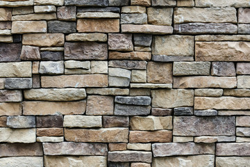 the stone wall texture background natural color.Background of stone wall texture photo.Natural...
