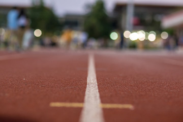 Soft focus Red running track and bokeh background in stadium. rubber running tracks in outdoor stadium.