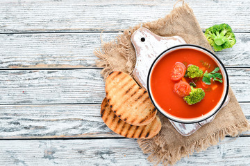 Tomato soup with vegetables and parsley. Mexican soup in a bowl. Top view.