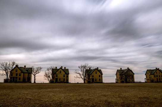 Stormy sky over abandoned old houses at Sandy Hook, New Jersey. Shot using slow shutter speed