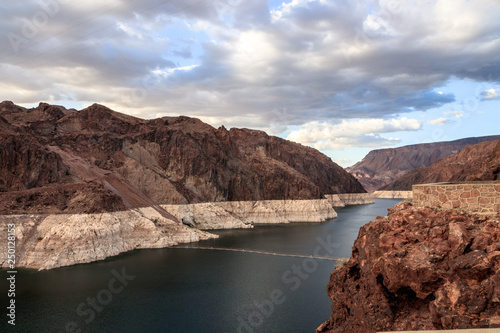 Hoover Dam is a concrete arch-gravity dam in the Black Canyon of the