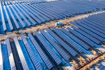 Aerial view of solar power station under construction in winter sunny day