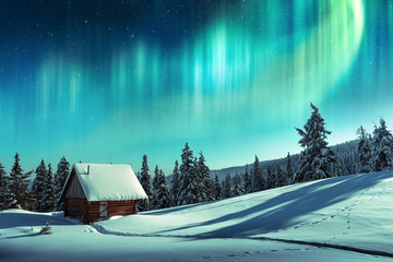Photo sur Aluminium Aurore polaire Fantastic winter landscape with wooden house in snowy mountains and northen light in night sky