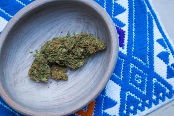 Marijuana in Ceramic Bowl on Blue Textile in Mexico (Overhead)