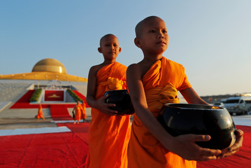 Buddhist novices are seen at the Wat Phra Dhammakaya temple during a ceremony to commemorate Makha Bucha Day outside Bangkok
