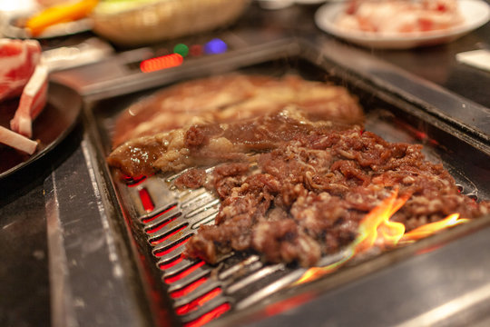 Korean BBQ Beef and Short Ribs on Flaming Stove With Smoke