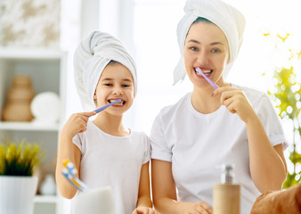 family are brushing teeth