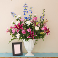 Pretty Pink and Lavender Flower Bouquet in White Vase with Blank Picture Frame with room or space for your words, text or copy.  Square crop