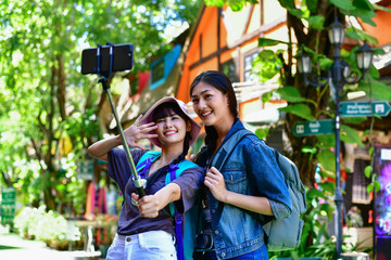 Travel and relaxing Concepts, Tourists are taking photos in the city. Asian girls are happily traveling. Beautiful girl is relaxing Travel. Asian girls are traveling in Asia.