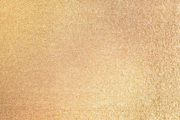 Close up of golden glitter textured background