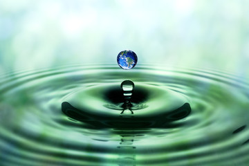 Falling drop of water with blue earth image