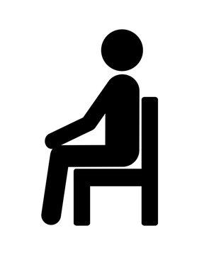 椅子に腰掛けている人