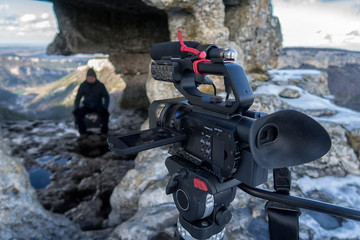 Video cameraman working with his professional equipment. professional video camera on the shooting of natural landscapes.