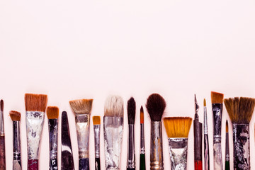 Art Creativity background. Row of dirty old brushes for oil, watercolors, acrylic
