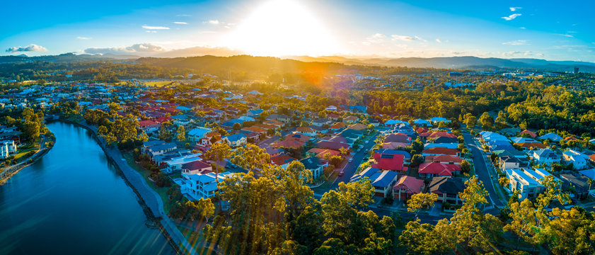 Sunset over luxury homes at Varsity Lakes suburb on the Gold Coast in Australia.