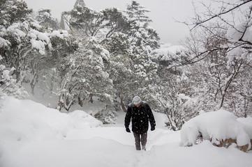Man walking after snowfall