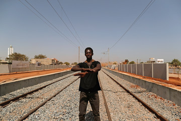 Cheikh Wane, 34, who said he lost his business because of the high speed rail project, speaks during an interview with Reuters in Mbao