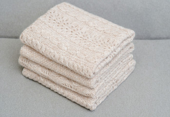 Stack of knitted plaids made by hand