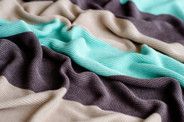 Striped multicolored blanket made of natural cotton.