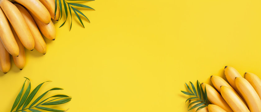 Bright yellow background with bunch of bananas