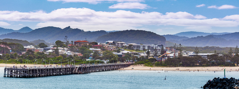 Panoramic landscape of Coffs Harbour jetty and luxury real estate. Coffs Harbour, New South Wales, Australia