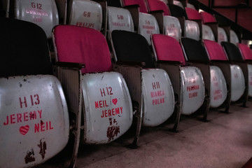 Stencilled names and messages of patrons who adopted seats in independent cinema The Projector's Redrum screening hall are seen in Singapore