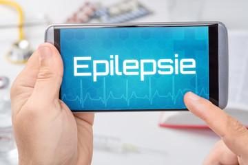 Smartphone mit dem Text Epilepsie auf dem Display