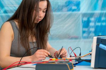 schoolgirl  in electronics class
