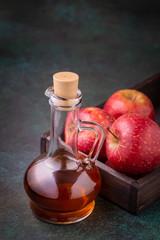 Bottle of apple organic vinegar on dark background
