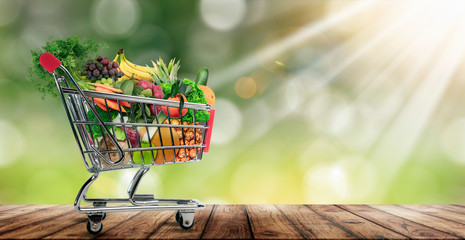 shopping cart with fruits and vegetables.
